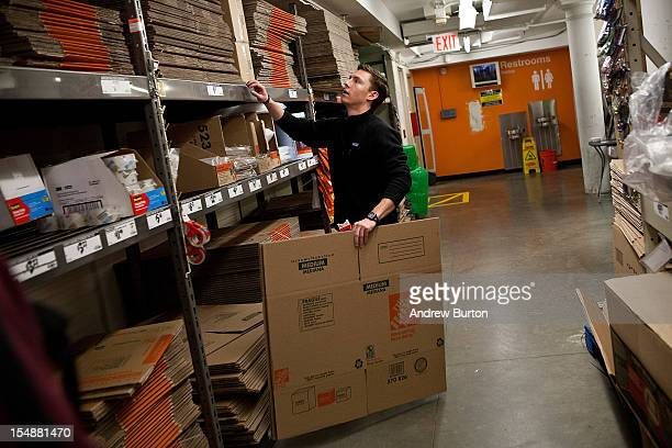 A man shops for cardboard boxes at Home Depot prior to the arrival of Hurricane Sandy on October 28 2012 in New York United States Sandy which has...