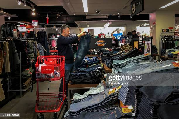 A man shops for jeans in a JCPenny store at the Manhattan Mall in the Herald Square neighborhood of Manhattan April 11 2018 in New York City US...