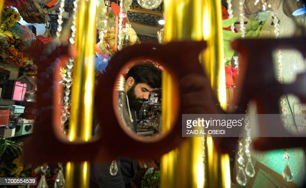 Man shops for Valenine's day presents at a gift shop in a shopping mall in Iraq's northern city of Mosul on February 13, 2020. - Mosul was formerly...