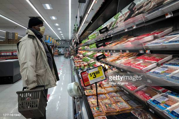 Man shops in the meat section at a grocery store, April 28, 2020 Washington, DC. Meat industry experts say that beef, chicken and pork could become...