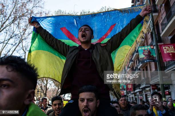 A man shouting holding an Amazigh flag during a demonstration calling for the release of political prisoners in the Rif region of Morocco