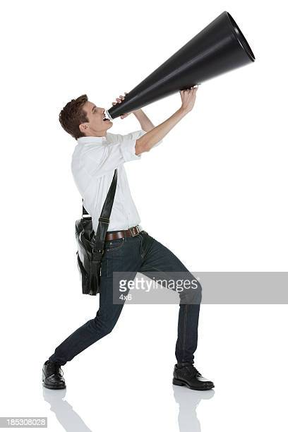 Man shouting into a bullhorn