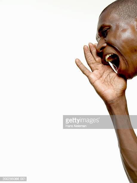 man shouting, side view - hans neleman ストックフォトと画像
