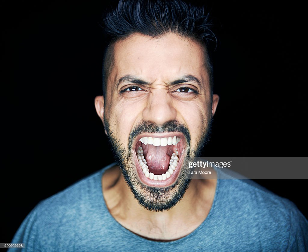 man shouting to camera : Stock Photo