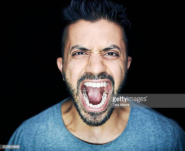 man shouting to camera - fury stock pictures, royalty-free photos & images