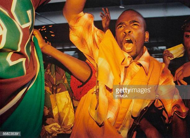 Man shouting to the music and waving arms Hip Hop/Westwood Stage Notting Hill Carnival London 1990s