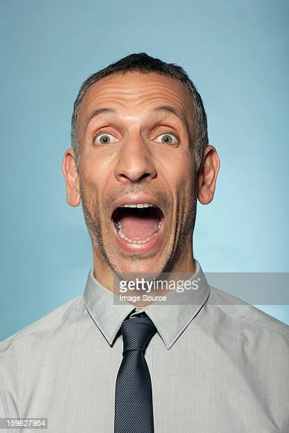 Man shouting with mouth open