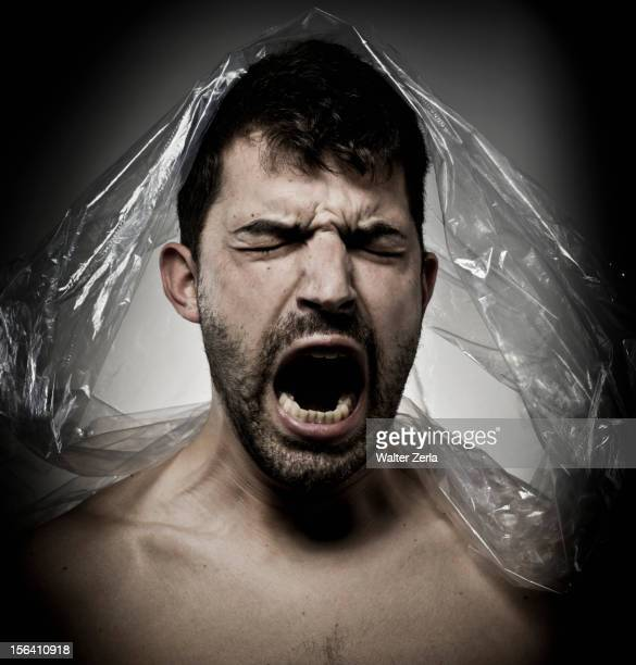 Man shouting with plastic on his head