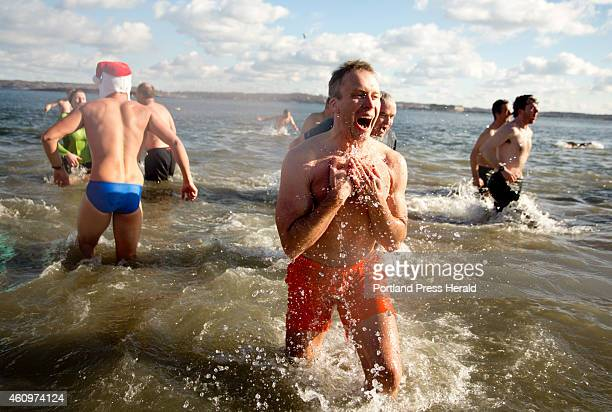A man shouts and laughs as he exits the chilly waters of East End Beach after participating in the Natural Resources Council of Maine's Polar Dip on...