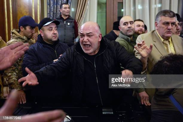 Man shouts angrily among a crowd of protestors who have stormed Armenian Prime Minister, Nikol Pashinian's office after the announcement of a peace...