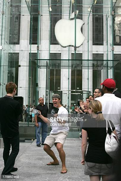 A man shouts as he leaves with his two iPhones at the Apple Store 29 June 2007 in New York Apple's iPhone one of the most eagerly awaited devices in...