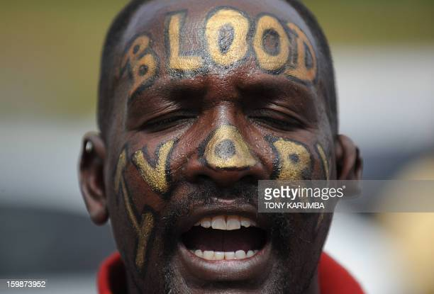 Man shouts during a protest ON January 22, 2012 in the Kenyan capital, Nairobi with the word's 'Blood Ivory' painted across his face when affiliates...