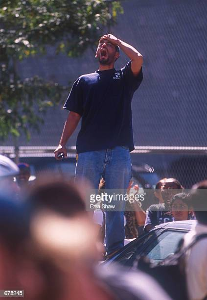 A man shouts for a friend reacting in horror to the World Trade Center's twin towers collapse after being struck by commerical airliners in a...