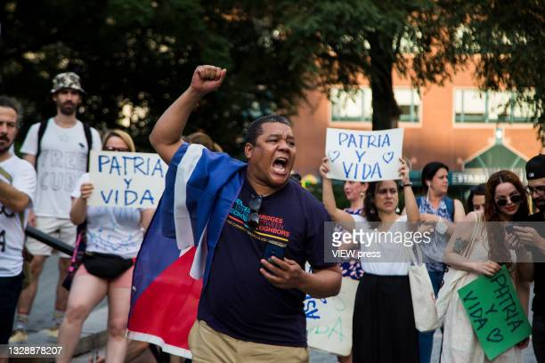 Man shouts in support of Cuban protesters in Union Square Park on July 14, 2021 in New York City. A small group of people gathered in Union Square...