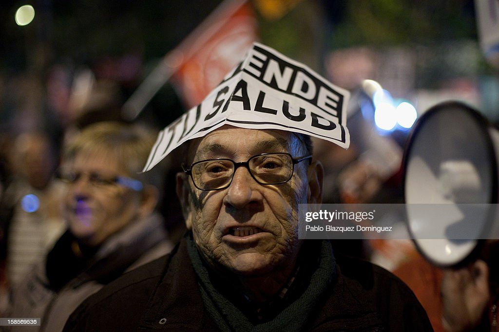 A man shouts slogans amid health workers during a demonstration outside Madrid Regional Asembly on December 19, 2012 in Madrid, Spain.As of today, health workers unions are calling for a third 48-hour strike against cuts on public health care and the privatization of medical centers and hospitals.