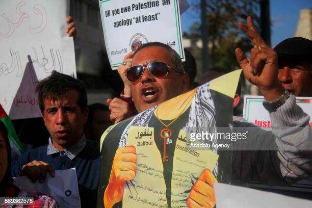 A man shouts slogans during a protest against the Balfour declaration during its 100th anniversary in Hebron West Bank on November 2 2017