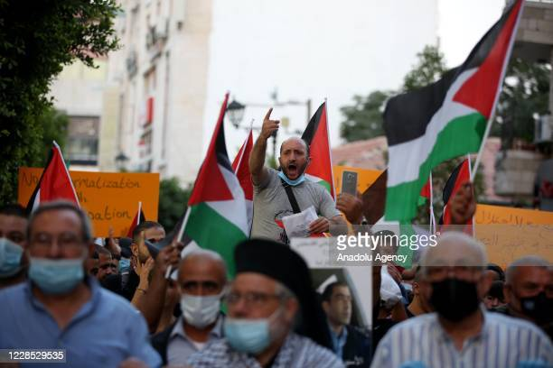 Man shouts slogans during a protest against United Arab Emirates' and Bahrain's deal to normalise ties with Israel at Manarah Square in Ramallah,...
