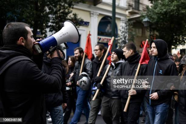 A man shouts slogans in a loud hailer as he leads a student protest in central Athens following a call by leftist groups opposed to a gathering by...