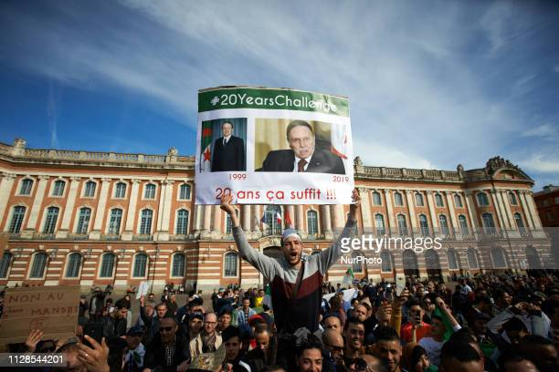 A man shouts while holding a placard reading '20 years it's enough ' Algerians in Toulouse gathered on the main square of Toulouse the Capitole to...