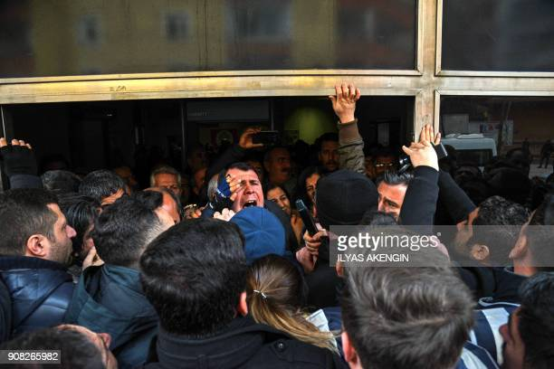 TOPSHOT A man shouts while Turkish anti riot police officers block People' Democracy Party's headquarter as HDP members call a protest against...