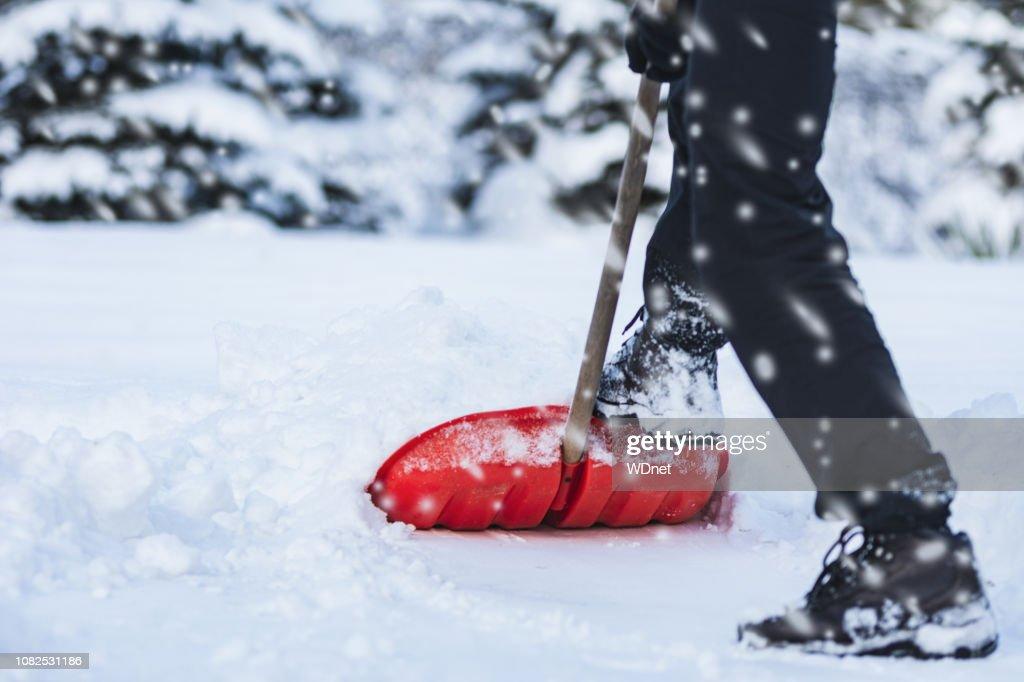 Man shoveling snow : Stock Photo