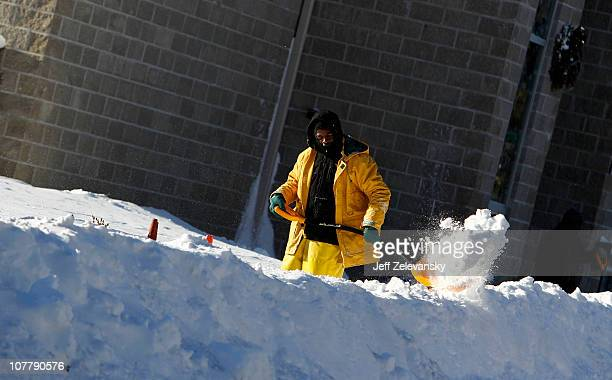 A man shovels snow from a walkway after a huge blizzard on December 27 2010 in Union New Jersey A massive snow storm with gusty winds and towering...