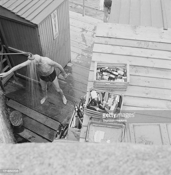 A man showering on Paraggi Beach near the tourist resort of Portofino Italy August 1952 Original Publication Picture Post 6023 unpub