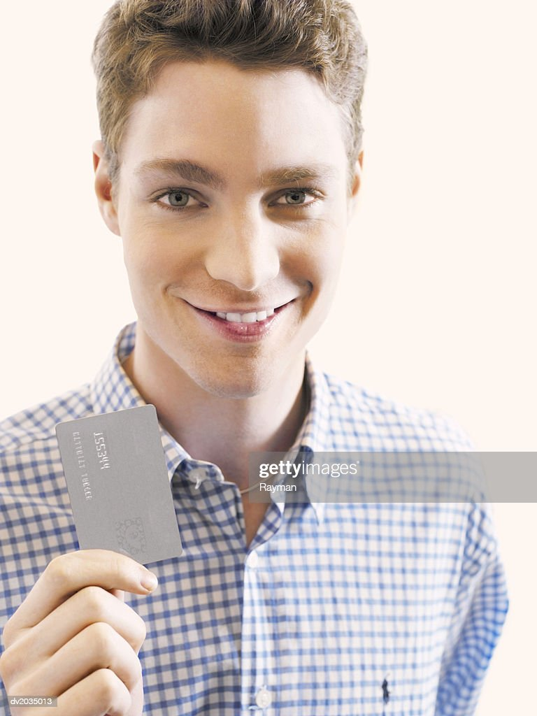 Man Showing a Credit Card : Stock Photo