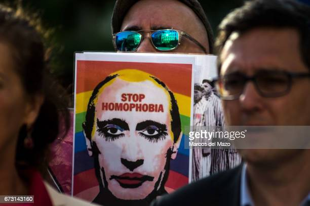 A man showing a picture of Vladimir Putting during a protest supporting LGTB in Chechnya