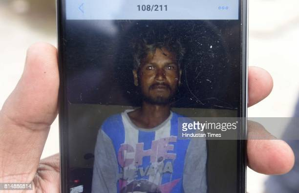 A man showing file photo of Anil Kumar who was died during the septic tank cleaning at Ghiloni in Chattarpur area on July 15 2017 in New Delhi India...