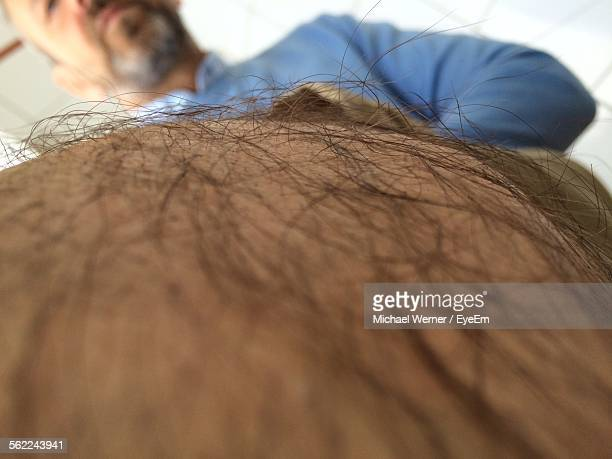 man showing hairy leg - hairy legs stock photos and pictures