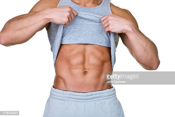 man showing his abs - abdominal muscle stock pictures, royalty-free photos & images