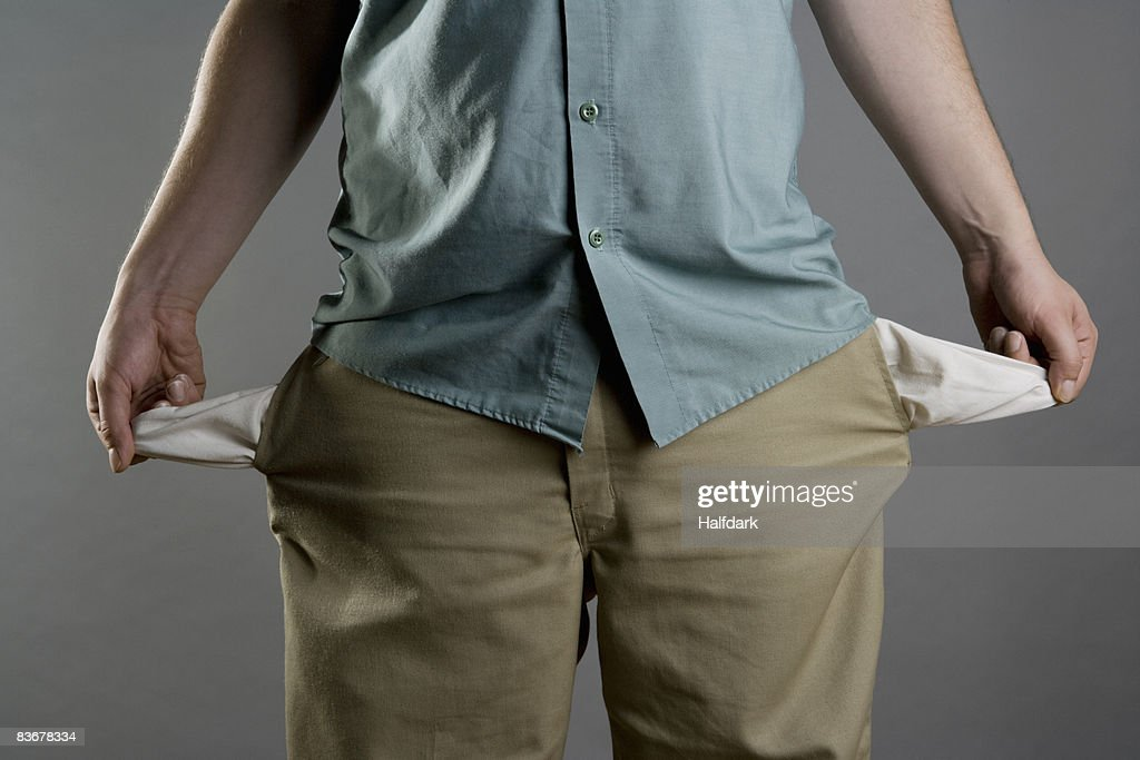 A man showing his empty pockets : Stock Photo