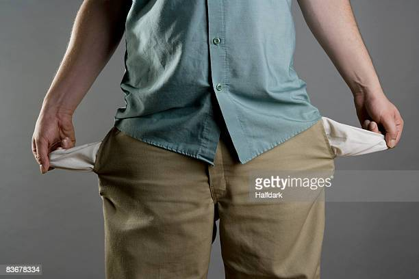 A man showing his empty pockets