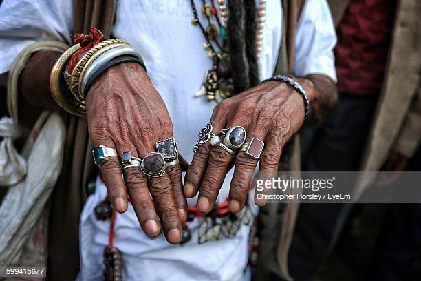 Man Showing His Hand With Various Rings