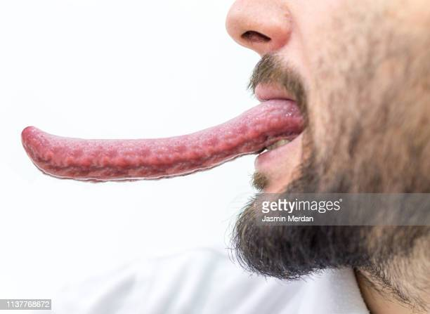 man showing his very long tongue - extra long ストックフォトと画像