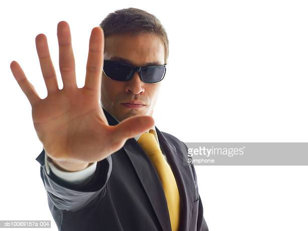 Man showing stop gesture, close-up, portrait