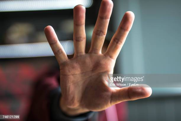 man showing stop gesture - dismissal stock photos and pictures