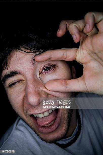 Man showing the reflection of a circle in his eye