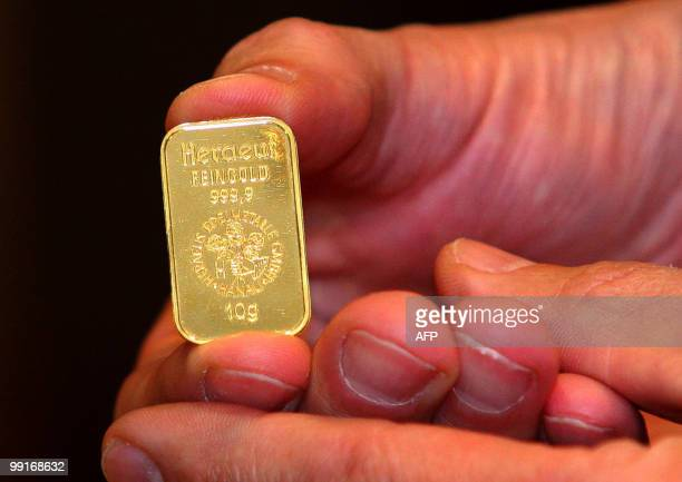 A man shows a 10gram gold ingot which he purchased from the 'Gold to Go' vending machine at the Emirates Palace Hotel in Abu Dhabi on May 12 2010...