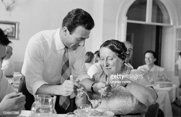 A man shows a female tourist how to eat spaghetti during a coach tour of Italy 1954 Original Publication Picture Post 7325 Coach Tour Of Italy unpub