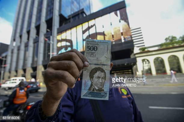 A man shows a new 500Bolivarnote in Caracas on January 16 2017 A new family of currency will progressively come into circulation in the South...