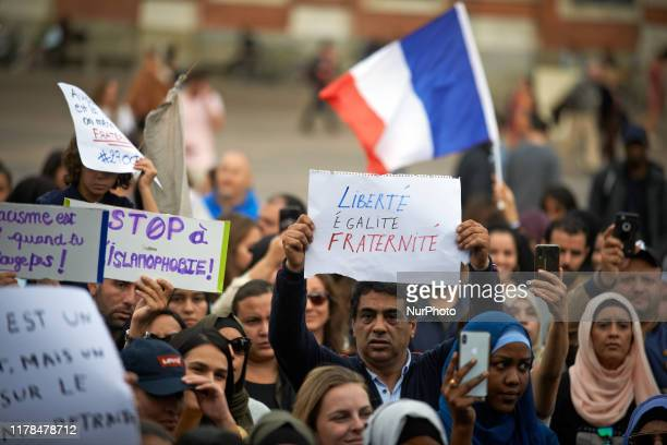 Man shows a paper with the French motto 'Liberty, Equality, Fraternity'. People gathered against islamophobia on the main square of Toulouse, the...