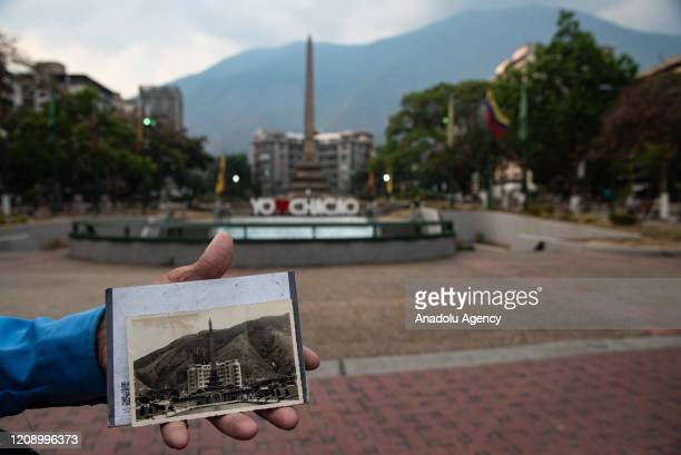A man shows a picture of Altamira Square taken 66 years ago and now it is empty as a preventive measure against the new type of coronavirus pandemic...
