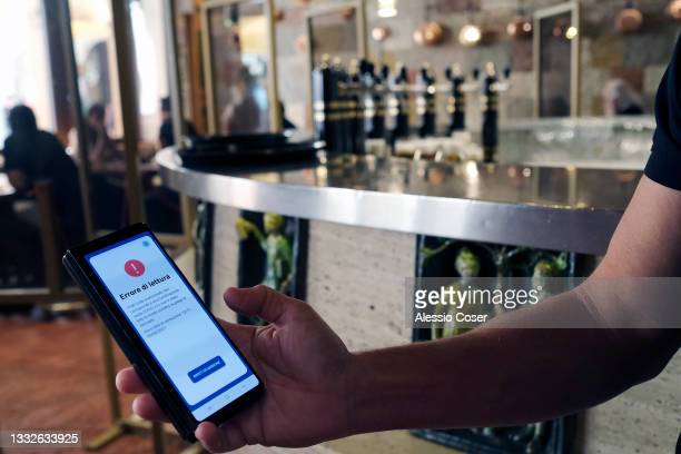 Man shows a reading with an app on a smartphone of a green pass that failed due to a reading error on August 05, 2021 in Trento, Italy. The Italian...
