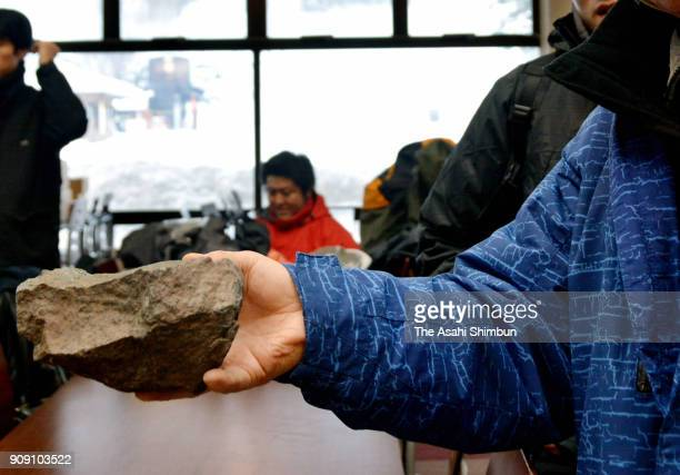 A man shows a rock fell after the eruption on January 23 2018 in Kusatsu Gunma Japan KusatsuShirane a 2160meter volcano erupted in the morning on...