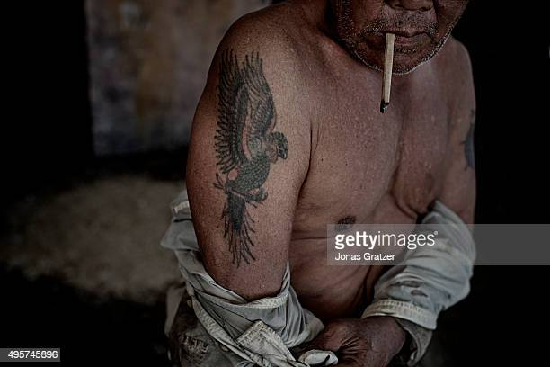 A man shows a tattoo of a 'spirit parrot' on his hard that he got in Hamburg in the 80s during his time as a sailor The people of Kiribati are under...