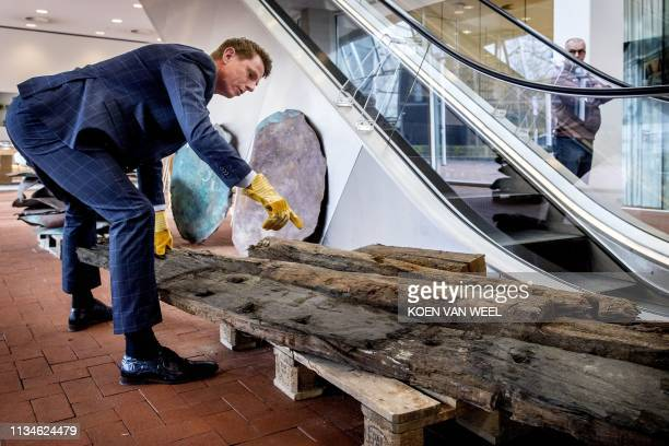 A man shows copper plates from a ship wreck from 1536 that was discovered during the storage of the containers that were lost of the MSC Zoe vessel...