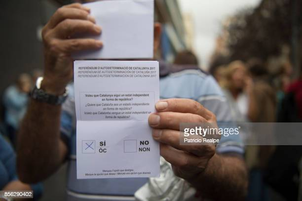 Man shows his ballot marked with Yes prior to vote in the referendum on October 1, 2017 in Barcelona, Spain. More than five million elegible Catalan...
