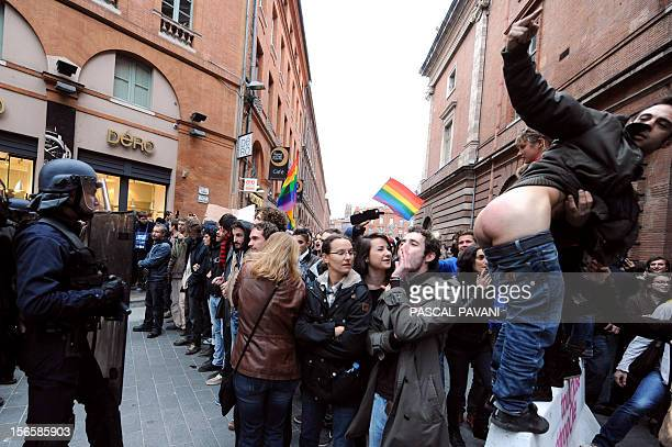 A man shows his buttocks to police as people take part in a demonstration in support with the samesex marriage on November 17 2012 in Toulouse...